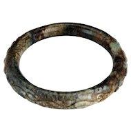 Chinese toroid form 65 mm mottled hardstone bangle bracelet Qing dynasty 19th century