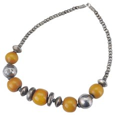 Vintage tribal necklace with large honey amber beads mixed with metal alloy beads circa 1930's