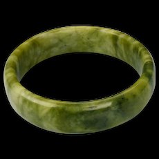 Vintage soft polished Chinese hard stone green bangle with dark green gray inclusions
