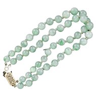 Chinese Pale Green Jadeite Double Strand Bracelet with 14K gold filigree clasp circa 1950