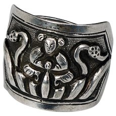 Antique Chinese Silver Ring with Repousse Immortal Design Late 19th Century