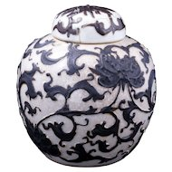 Chinese porcelain ginger jar with lid and raised design of peony scroll circa 1900