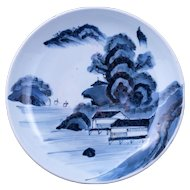 Antique large Japanese porcelain blue and white shallow bowl fishing village scene 19th century