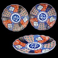 Set of three colorful Antique Japanese Imari porcelain plates Meiji Period 19th century set 2 of 4