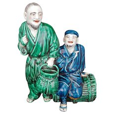 Large Japanese Kutani enameled figure of two fishermen Meiji period circa 1900