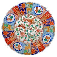 Japanese colored Imari porcelain scalloped edged plate with butterflies among flowers late 19th century