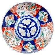 Large Japanese porcelain colored Imari charger 19th century