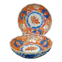 Matched pair of Japanese porcelain colored Imari bowls with scalloped edges 19th century