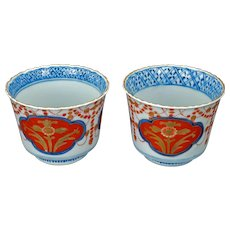 Matched pair of Japanese porcelain colored Imari tea cups early 20th century