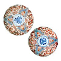 Matched pair of colored Imari porcelain dishes with phoenix designs 19th century