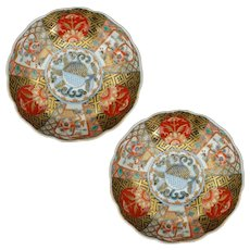 Matching pair of round Japanese porcelain colored Imari bowls with scalloped edges 19th century