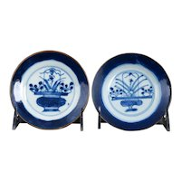 Pair Chinese Kangxi Flower Basket Blue and White Saucers Circa 1700