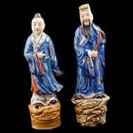 Pair of Chinese porcelain immortal figures riding clouds with over glaze enamel decoration circa 1900