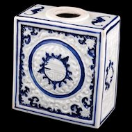Chinese square tea caddy molded with a scrolled design glazed in a white and deep blue glaze early 20th Century