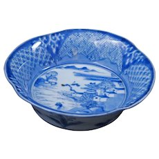 Small Japanese blue and white Imari bowl with castle and ocean design 19th century