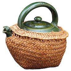 Chinese green glazed teapot with lid, frog spout and woven wicker case circa 1900