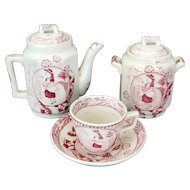 "Child's Staffordshire red transfer ware Charles Allerton ""Little May with Apron"" tea set circa 1880"