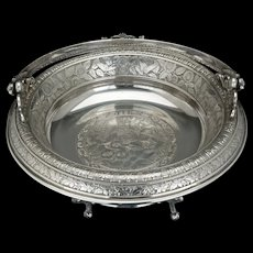Victorian silver plate cake basket by Rogers and Brothers with a bird and nest design circa 1870