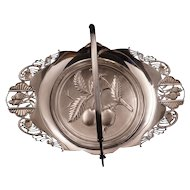 Victorian silver plate cake basket by Pairpoint with a design of cherries and lovebirds circa 1870