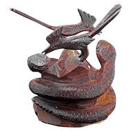 Western folk art wood carving of entwined rattle snakes and roadrunners early 20th century