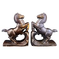 Pair of graceful metal art deco horse bookends from the 1930's
