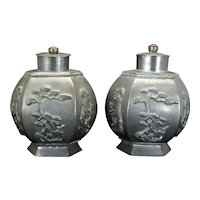 Pair of Chinese metal tea caddies with auspicious symbols and carnelians circa 1900