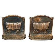 Covered wagon motif heavy cast iron bookends by WH Howell circa 1926