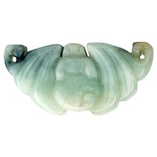 Chinese pale green jade with dark inclusions toggle in the shape of a bat