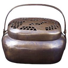 Chinese brass hand warmer with pierced top early 20th century