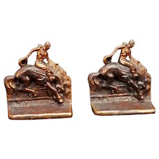 Bucking Bronco Rider Bookends Metal with Copper Patina Circa 1930