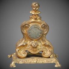 Cast Metal Dollhouse Mantle Clock in the Rococo Taste