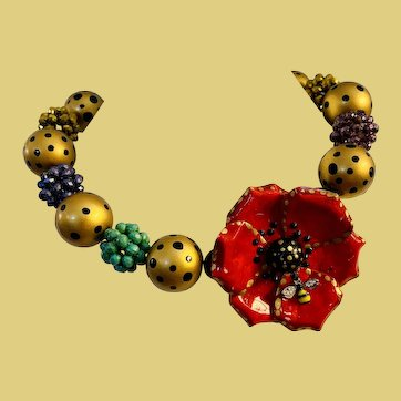 Unique one-of-a-kind red flower necklace gold and black painted polka dots -jewel tone colors bold and beautiful a tiny bee sits on the flower sure to get attention handpainted handmade
