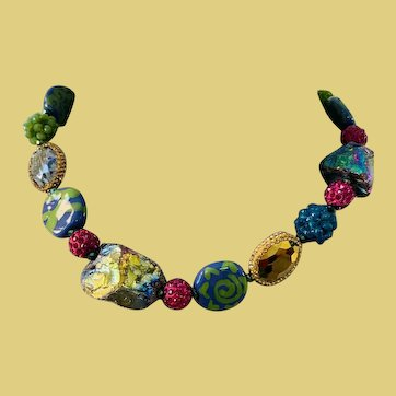 Gorgeous jewel tone necklace featuring African Kazuri beads- crystal beads- and fire agate