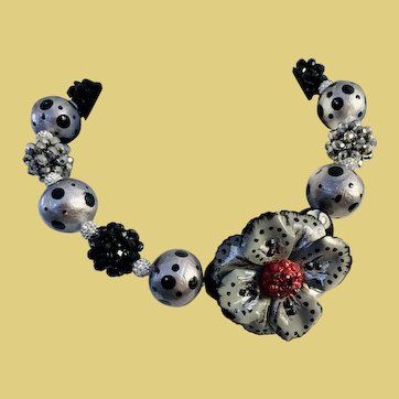 Grey black and silver toned beaded necklace with focal flower. Whimsical and sophisticated at the same time