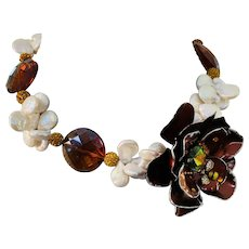 Artisan Collage Necklace with Flower Focal  - Simulated Pearls   and Crystal in Bronze Tones  OOAK