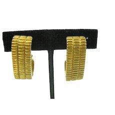 Pierre Cardin clip on earrings in gold tone metal