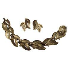 Trifari Silver tone leaf design bracelet and earrings