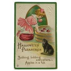 Little Girl Bobbing For Halloween Apples Postcard