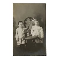 RPPC- Clara Jean and George Lester With Teddy Bear