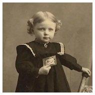 Studio Photo-Sweet Clara Helene Holding Photograph