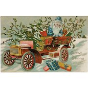 Santa In Blue With Automobile