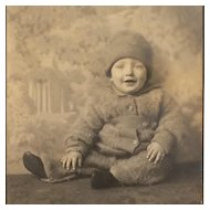 Studio Photo- Happy Baby In Winter Snowsuit