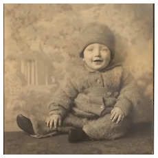 Studio Photo- Happy Baby In Winter Snowsuit