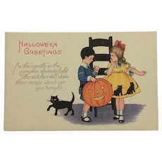 Halloween Boy With Big Pumpkin Postcard