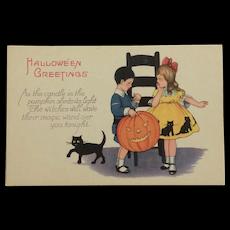 Halloween Boy With Big Pumpkin Postcard