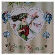 Schmucker- Beauty In Green With Heart Shaped Guitar