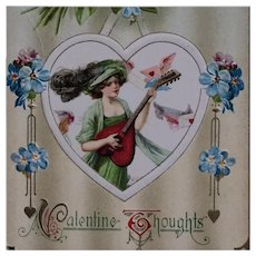 Schmucker- Beauty In Green With Heart Shaped Guitar