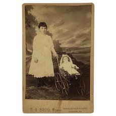 Cabinet Card- Young Girl With Doll In Toy Buggy