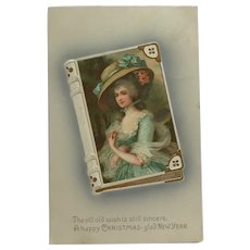 Elegant Lady On Book With Holiday Greeting Postcard