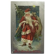 Tuck's Santa In Red With Gift Sled Postcard